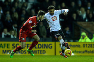 Cyrus Christie of Derby County (right)  gets away from Matt Grimes of Blackburn Rovers (left) during the Sky Bet Championship match at the iPro Stadium, Derby<br /> Picture by Andy Kearns/Focus Images Ltd 0781 864 4264<br /> 24/02/2016