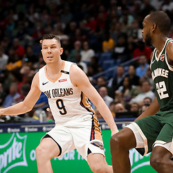 Mar 12, 2019; New Orleans, LA, USA; New Orleans Pelicans guard Dairis Bertans (9) is defended by Milwaukee Bucks forward Khris Middleton (22) during the second quarter at the Smoothie King Center. Mandatory Credit: Derick E. Hingle-USA TODAY Sports