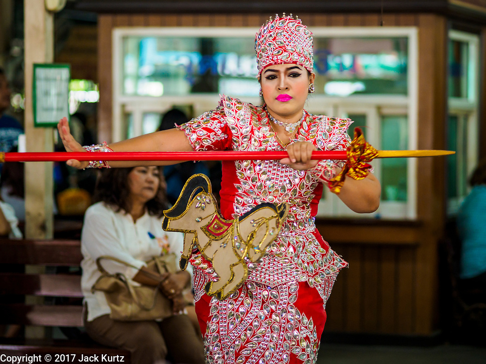 31 MAY 2017 - CHACHOENGSAO, THAILAND: A traditional dancer performs at Wat Sothon (also spelled Sothorn) in Chachoengsao, Thailand. The temple is one of the largest and most visited in Thailand. People make merit by paying for traditional dances, or wrapping the Buddha statues in orange robes. The temple is most famous because people leave hard boiled eggs as an offering at the temple. They ask for business success or children and leave hundreds of hard boiled eggs.      PHOTO BY JACK KURTZ