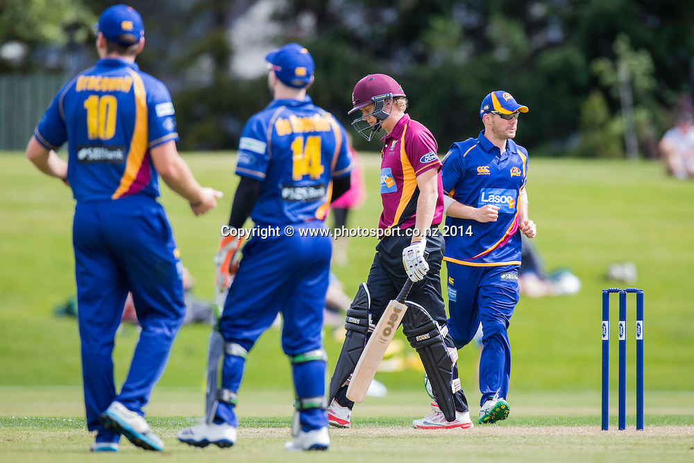 Scott Kuggeleijn bats for the Northern Knights and gets caugt by Sam Blakely of the Otago Volts - Volts v Knights, Saturday, 27 December 2014, Molyneux Park, Alexandra - List-A Match - Ford Trophy CREDIT: Libby Law / www.photosport.co.nz