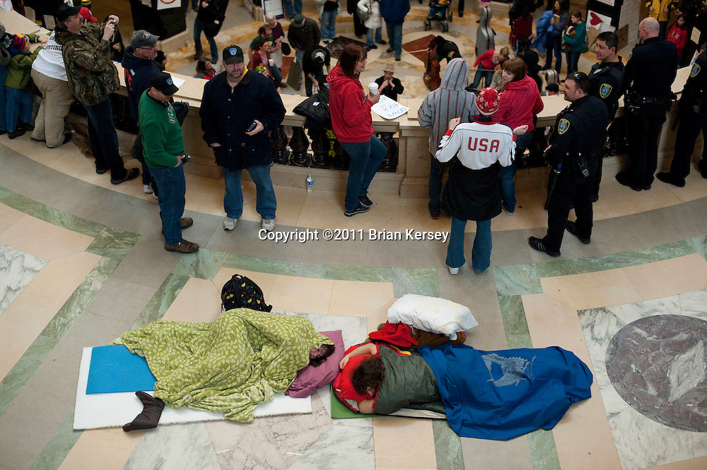 Protesters sleep at the state Capitol in Madison, Wisconsin on February 25, 2011. Protests over the pending legislation continued for the 11th day.  (Photo by Brian Kersey)