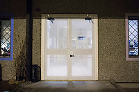 "MILANO, ITALY - 1 MARCH 2016: The entrance door of the ""InGalera"" restaurant, which resembles a prison cell gate, is here at the Bollate prison in Milan, Italy, on March 1st 2016.<br /> <br /> ""InGalera"" (which translates in English as ""InJail"") is the first restaurant located inside a prison and offering high-quality cooking to the public and a future to the inmates. It was inaugurated last October inside the Bollate prison in Milan. It is open five days a week for lunch and dinner, and seats 55 people. There are 9 people involved in the project, including cooks and waiters, all regularly employed and all inmates of the prison, apart from the chef and the maître d'hôtel, recruited from outside to guarantee the high quality of the food served. The restaurant is a project of the co-operative ABC La Sapienza - that operates inside the prison and provides more than 1,000 meals three times a day with the help of inmates they've hired - and of PwC, a multinational operating in the field of corporate consultancy. The goal of this project is to follow prisoners in rehabilitation process of social inclusion.<br /> <br /> The Bollate prison is already known for being a good example of penitentiary administration. The inmates are free to move around from one area to the other inside the prison (their cells open at 7:30am and close at 9pm) to go study, exercise in a gym, or work (in a call center, as scenographers, tailors, gardeners, cooks, typographers, among others)  in one of the 11 co-operatives inside the prison or in one of the private partnering businesses outside the prison. The turnover of the co-operatives that work inside the prison was €2mln in 2012."