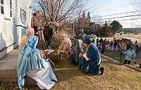 "The Gilford Community Church presented the Living Nativity scene Sunday afternoon outside the Thompson Ames Historical Society.  Mary (Kathy Lacroix), Joseph (Jim Colby), Innkeeper (Peter Ayer), Kathy Salanitro with ""Chip"" and the Three Wise Men (George Hetherington, Carl Gebhardt and Leon Albushies).  (Karen Bobotas/for the Laconia Daily Sun)"