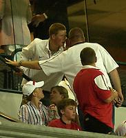 Photo: Richard Lane.<br />England v Wales.  Quarter-Final 2, at the Suncorp Stadium, Brisbane. RWC 2003. 09/11/2003.<br />Prince Harry whispers.