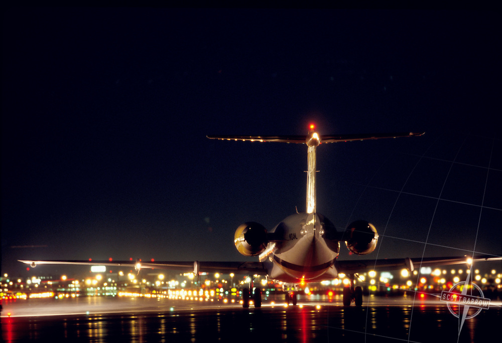 Commercial Airliners Waiting For Take Off At Night