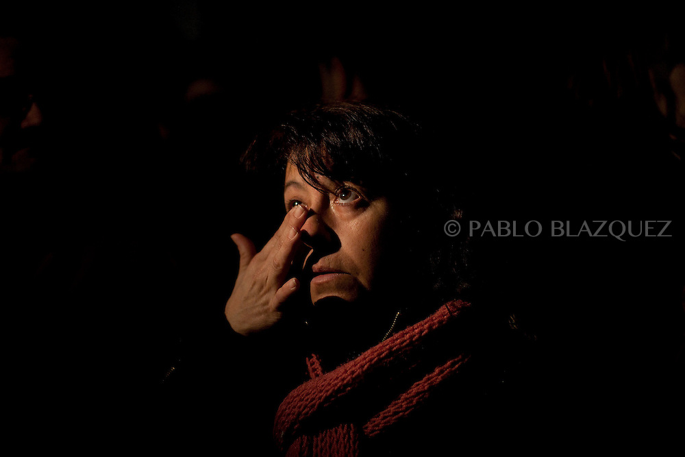 A woman cries outside the local healthcare centre which closed at 8pm tonight its emergency hours on January 14, 2013 in Tembleque, near Toledo, Spain. A total of 21 centres, specially in rural areas, in the region of Castilla-La Mancha, are eliminating emergency hours services following budget cuts and privatisations in Spanish health services.