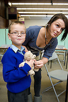 NUI Galway Medical Student Fiona Nolan from Wicklow  at the Teddy Bear Hospital in the Unversity where Luke Finnerty from Kilbeacanty Co. Galway got his Teddys healed . Photo:Andrew Downes.