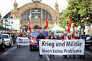 Frankfurt am Main | 30 Aug 2014<br /> <br /> Am Samstag (30.08.2014) demonstrierten &uuml;ber 200 Aktivisten aus dem Umfeld der Partei &quot;Die Linke&quot; und anderen linken und linksradikalen Zusammenh&auml;ngen gegen Krieg und f&uuml;r Frieden. Einige ukrainische Nationalisten und Aktivisten der dubiosen Montagsmahnwache in Frankfurt hatten sich unter die Friedensdemonstranten gemischt.<br /> Hier: Beginn der Demo im Kaisersack am Hauptbahnhof Frankfurt in der Kaiserstra&szlig;e, Transparent mit der Aufschrift &quot;Krieg und Milit&auml;r l&ouml;sen keine Probleme&quot;.<br /> <br /> &copy;peter-juelich.com<br /> <br /> [No Model Release | No Property Release]