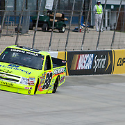 Matt Crafton #88 arounds turn two Friday May. 13, 2011. during NASCAR Camping World Truck Series practice race at Dover International Speedway in Dover Delaware..