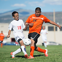 090314      Cayla Nimmo<br /> <br /> Grants Pirate junior Shaun Sanchez (19) and Gallup Bengal freshman Joel Garcia (26) battle for possession of the ball during the game at Grants High School Wednesday afternoon.