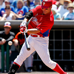 March 25, 2012; Clearwater, FL, USA; Philadelphia Phillies first baseman Jim Thome (25) hits a fly out during the bottom of the first inning of a spring training game against the Baltimore Orioles at Bright House Networks Field. Mandatory Credit: Derick E. Hingle-US PRESSWIRE