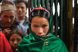 A nine-months pregnant Niruta, 14, arrives at her wedding ceremony in Kagati village Nepal on Jan. 23, 2007, which was the auspicious day of Vasant Panchami, a Hindu holiday celebrating the coming of spring.  Niruta moved in with the family of Durga, 16, the year before and was pregnant three months later. <br />