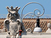 Decorative detail from the area surrounding Castel Sant'Angelo and the Ponte Sant'Angelo in Rome, Italy. Many decorative sculptural and architectural details adorn the length of the bridge, as well as the area surrounding it and the Castel Sant'Angelo. This image shows a decorative bell.