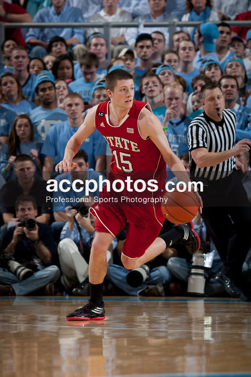 CHAPEL HILL, NC - JANUARY 26: Scott Wood #15 of the North Carolina State Wolfpack dribbles the ball during a game against the North Carolina Tar Heels on January 26, 2012 at the Dean E. Smith Center in Chapel Hill, North Carolina. North Carolina won 55-74. (Photo by Peyton Williams/UNC/Getty Images) *** Local Caption *** Scott Wood