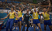 Members of the Brazilian gymnastic team react as a teammate secures the gold medal during the team competition at the PanAmerican Games in Guadalajara, Mexico. (2011)