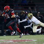 November 06, 2015; Oregon City, OR, USA; TANNER SMITH (49) runs the ball.  Oregon City hosted Southridge at Pioneer Stadium.  Photo by David Blair