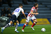Stoke City midfielder Joe Allen(4) goes past Preston North End midfielder Josh Harrop (10) during the EFL Sky Bet Championship match between Preston North End and Stoke City at Deepdale, Preston, England on 21 August 2019.