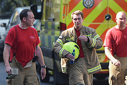 © Licensed to London News Pictures. 23/08/2019. London, UK.  Firefighters attending scene. A fire broke out on the 12th floor of a tower block very close to the devastating inferno that destroyed Grenfell Tower killing 72 people two years ago. Ten engines and 70 firefighters brought the blaze under control which gutted the apartment and spread externally along satellite cables. Residents of Markland House self evacuated and commented that no fire alarms were heard in the building.  Photo credit: Guilhem Baker/LNP
