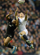 Twickenham, United Kingdom, Right, England's Mike BROWN jumping with NZL. Julian SAVEA,  during the 2013 QBE  AutumnRugby International, England vs New Zealand, played  Saturday  16/11/2013 at the RFU Stadium Twickenham,<br />