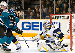 January 23, 2010; San Jose, CA, USA; San Jose Sharks left wing Dany Heatley (15) scores past Buffalo Sabres goalie Ryan Miller (30) during the second period at HP Pavilion. San Jose defeated Buffalo 5-2. Mandatory Credit: Jason O. Watson / US PRESSWIRE