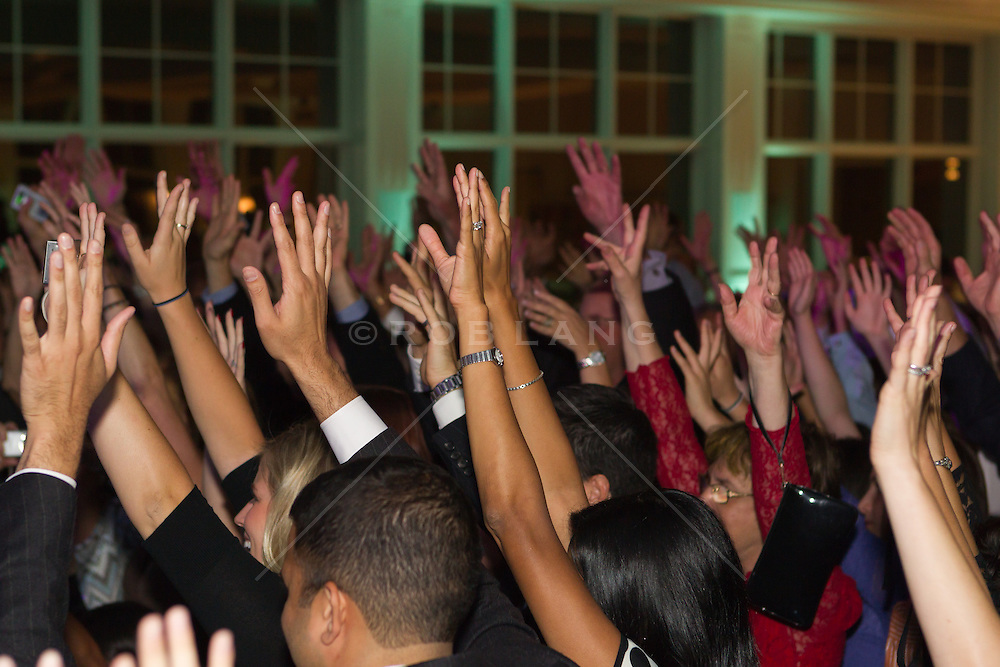 hands in the air at a party