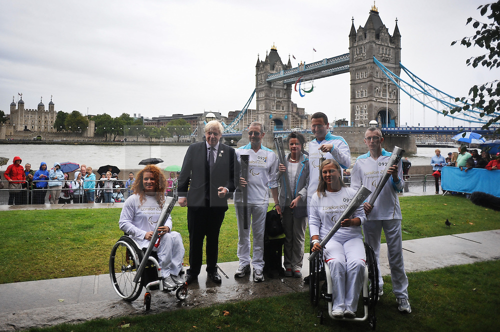© Licensed to London News Pictures. 29/08/2012. London,UK.The Mayor of London Boris Johnson and five torchbearers - Paralympians Jan Wilson, William Noble, Esther Weber, Jim Nuirhead and Francesca Porcellato takes part in a photocall in front of Tower Bridge and the newly-installed Paralympic Agitos. .Photo credit : Thomas Campean/LNP.