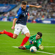 PARIS, FRANCE - September 10:   Olivier Giroud #9 of France rounds goalkeeper Josep Gómes #1 of Andorra but shoots wide from a tight angle during the France V Andorra, UEFA European Championship 2020 Qualifying match at Stade de France on September 10th 2019 in Paris, France (Photo by Tim Clayton/Corbis via Getty Images)