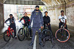 "Left to right, Trizzy, 16, Liam Ross, 17, Mac Ferrari with his dog Xuki, Tevon 'TJ Jules, 13, and Pharell ""PJ"" Samuel, 16. Bikestormz is the brainchild of leader Mac Ferrari, a group of young trick cyclists who are encouraged to put knives down and enjoy the healthy, positive side of urban youth culture by joining together  and developing their cycling skills. London, September 27 2019."
