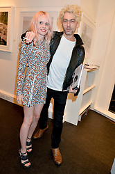 TIM NOBLE and SCARLETT CARLOS CLARKE at a private view to celebrate the 25th anniversary of the publication of White Heat featuring the photographs by Bob Carlos Clarke of Marco Pierre White held at the Little Black Gallery, 13 A Park Walk, London on 10th February 2015.