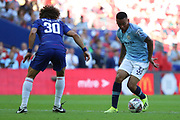 Manchester City Forward Gabriel Jesus (33) taking on Chelsea defender David Luiz (30) during the FA Community Shield match between Chelsea and Manchester City at Wembley Stadium, London, England on 5 August 2018.
