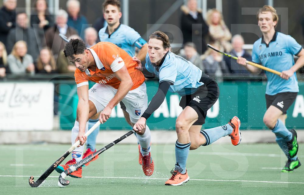 WASSENAAR - Hoofdklasse hockey heren, HGC-Bloemendaal (0-5)  . Glenn Schuurman (Bldaal) met rechts Pelle Vos (HGC) .    COPYRIGHT KOEN SUYK