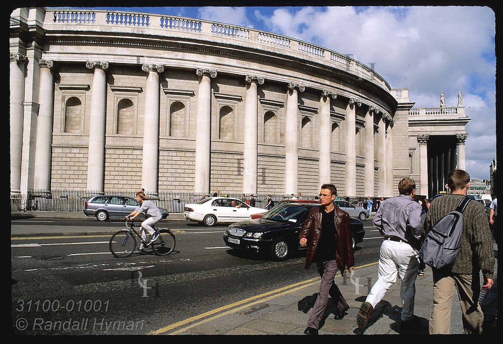 Students bustle along busy College Street across from Arts Centre at Trinity College entrance on a September day; Dublin, Ireland.