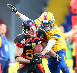 03.06.2014, NV Arena, St. Poelten, AUT, American Football Europameisterschaft 2014, Gruppe A, Schweden (SWE) vs Deutschland (GER), im Bild Niklas Roemer, (Team Germany, WR, #84) und Marion Escobar, (Team Sweden, DB, #25) // during the American Football European Championship 2014 group A game between Sweden vs Germany at the NV Arena, St. Poelten, Austria on 2014/06/03. EXPA Pictures © 2014, PhotoCredit: EXPA/ Thomas Haumer