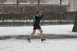 © Licensed to London News Pictures. 28/02/2018. London, UK. A jogger runs through snow in his shorts in Greenwich Park following heavy snowfall and sub zero temperatures overnight. The cold weather originating in Siberia has been dubbed 'the Beast from the East'.  Photo credit : Tom Nicholson/LNP