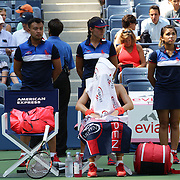 Simona Halep, Romania, waits in her seat with a towel on her head as her opponent  Marina Erakovic, New Zealand receives treatment on Arthur Ashe Stadium in the first round of the Women's Singles during the US Open Tennis Tournament, Flushing, New York, USA. 1st September 2015. Photo Tim Clayton