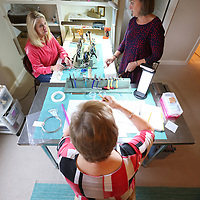 Jabrielle Cooper, from left, Teresa Mendenhall and Julianne Goodwin gather around three small tables in Coopers house and spend hours together making jewerly for their new business called MSmade.