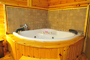 Israel, Galilee, Interior of a rural guesthouse cabin. whirlpool bathtub