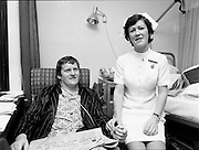 Following a training ground accident at the Ireland team trials, rugby international Barry McGann was admitted to St. Vincent's Nursing Home, Merrion Road, Dublin, for treatment and recuperation. Taking his pulse is Staff Nurse C. Houlihan.<br />