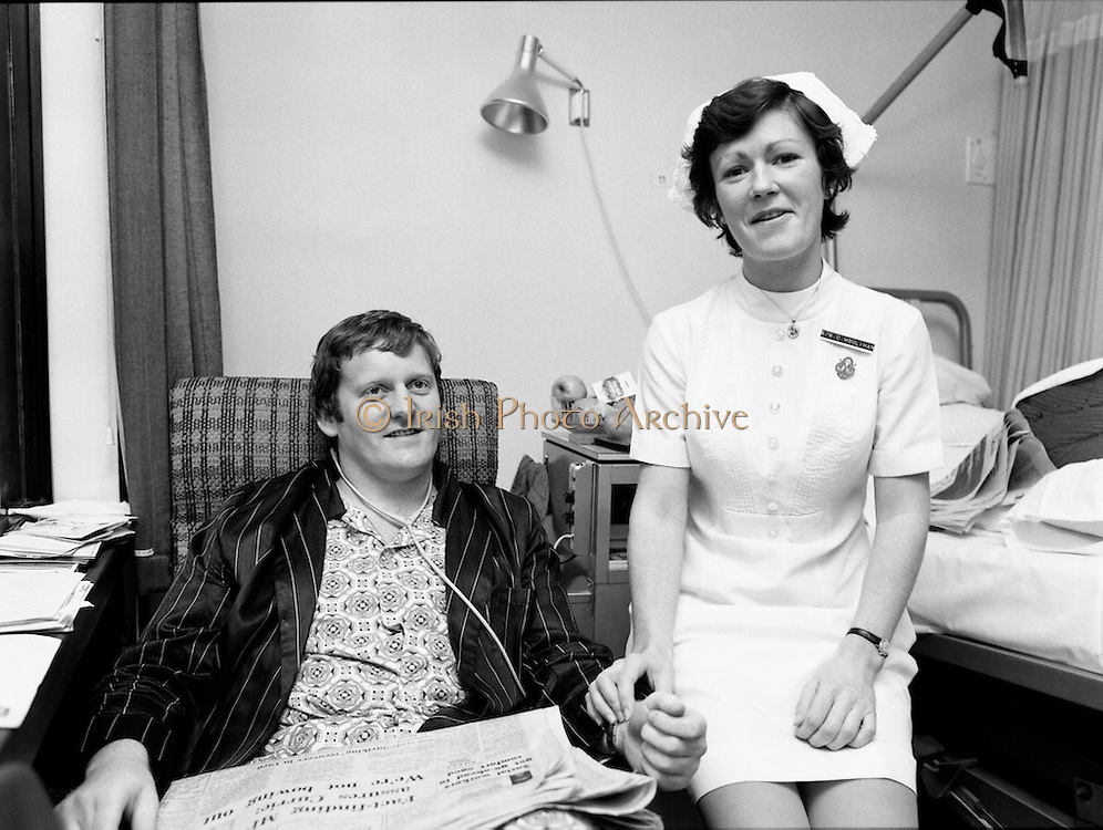 Following a training ground accident at the Ireland team trials, rugby international Barry McGann was admitted to St. Vincent's Nursing Home, Merrion Road, Dublin, for treatment and recuperation. Taking his pulse is Staff Nurse C. Houlihan.<br /> 13/01/1977