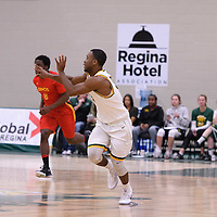 1st year guard Johneil Johnson (3) of the Regina Cougars in action during the home game on January  27 at Centre for Kinesiology, Health and Sport. Credit: Arthur Ward/Arthur Images