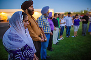 07 AUGUST 2012 - PHOENIX, AZ: People join hands in prayer during a prayer service at the Arizona Interfaith Movement offices in Phoenix. Arizona Interfaith Movement consists of 25 different faith traditions. They hosted an interfaith Prayer Circle Tuesday night where attendees offered moments of prayer in their own faith tradition for the victims of the massacre at the Sikh temple in Wisconsin last Sunday. About 60 people attended the service.    PHOTO BY JACK KURTZ