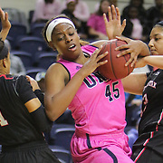 UNCW's Ryan Flowers holds on to a rebound against Northeastern's Amencie Mercier, left, and Francesca Sally Sunday February 15, 2015 at Trask Coliseum. (Jason A. Frizzelle)
