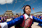 20 February 2007 - Shangarila, China - A Tibetan women dances a traditional Tibetan dance during Chinese New Year celebration.<br /> Photo credit: Luke Duggleby