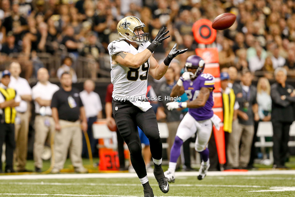 Sep 21, 2014; New Orleans, LA, USA; New Orleans Saints tight end Josh Hill (89) catches a touchdown against the Minnesota Vikings during the first quarter of a game at Mercedes-Benz Superdome. Mandatory Credit: Derick E. Hingle-USA TODAY Sports