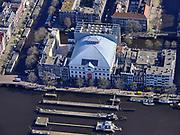 Nederland, Noord-Holland, Amsterdam; 23-03-2020; Amstel en Amstelsluizen met Koninklijk Theater Carré, met motto Zorg goed voor elkaar.<br /> Het publieke leven in het centrum van de hoofdstad is bijna geheel stil komen te liggen als gevolg van het Corona virus. Niet alleen is alle horeca dicht, ook veel winkels en andere bedrijven zijn gesloten. Het publiek blijft over het algemeen binnen, de straten en pleinen zijn stil.<br /> River Amstel, city centre.<br /> Public life in the center of the capital has come to a complete standstill as a result of the Corona virus. Not only are all pubs, coffee shops and restaurants,  closed, many shops and other companies are also closed. The public generally stays inside, the streets and squares are very quiet.<br /> <br /> luchtfoto (toeslag op standaard tarieven);<br /> aerial photo (additional fee required)<br /> copyright © 2020 foto/photo Siebe Swart