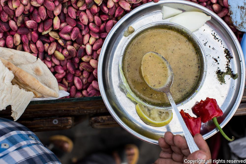 Pistachio seller's breakfast, Sanliurfa, Turkey. Mercemek Corbasi (red lentil soup), served with lemon, dried mint and fresh red 'Urfa' pepper.