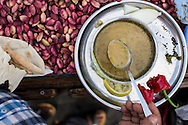Pistachio seller's breakfast, Sanliurfa, Turkey. Mercemek Corbasi (red lentil soup), served with lemon, dried mint and fresh red 'Urfa' pepper.