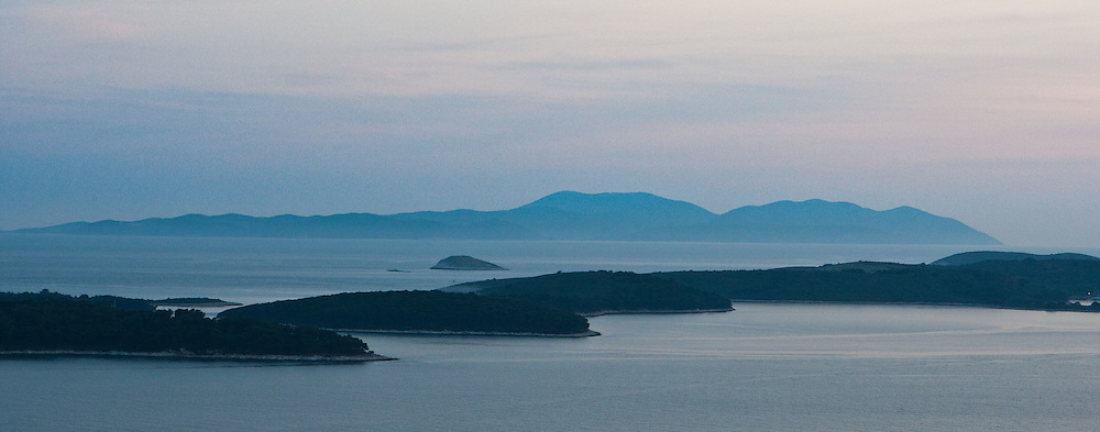 The Paklinski islands and Vis Island further off seen from above Hvar Town.