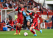 Aaron Amadi-Holloway takes on Christian Scales during the Sky Bet League 2 match between Crawley Town and Wycombe Wanderers at the Checkatrade.com Stadium, Crawley, England on 29 August 2015. Photo by David Charbit.