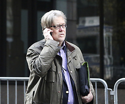 August 18, 2017 - FILE - President Trump's chief strategist STEVE BANNON has stepped down from his position at the White House. The resignation was effective on August 14th, exactly one year after he joined the Trump campaign. Pictured: December 9, 2016 - New York, US - Steve Bannon, chief strategist for President Trump, makes a phone call in the street next to the Trump Tower, New York. (Credit Image: © Aude Guerrucci/CNP via ZUMA Wire)